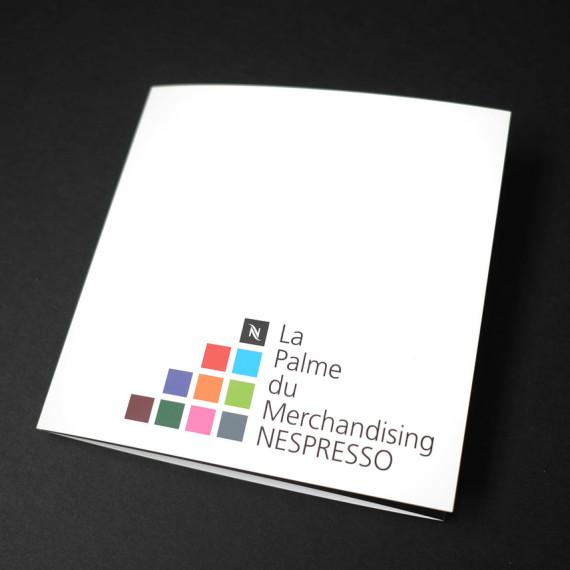 """Création du logo et de la charte graphique pour La Palme du Merchandising Nespresso. Contenu de la page """"Agence de communication""""."""